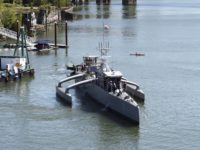 160407-N-PO203-577 PORTLAND, Oregon (Apr. 7, 2016) Sea Hunter, an entirely new class of unmanned ocean-going vessel gets underway on the Williammette River following a christening ceremony in Portland, Oregon. Part the of the Defense Advanced Research Projects Agency (DARPA)'s Anti-Submarine Warfare Continuous Trail Unmanned Vessel (ACTUV) program, in conjunction with the Office of Naval Research (ONR), is working to fully test the capabilities of the vessel and several innovative payloads, with the goal of transitioning the technology to Navy operational use once fully proven. (U.S. Navy photo by John F. Williams/Released)